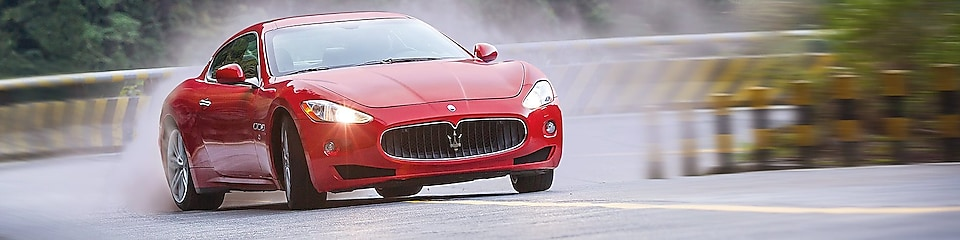 A red Maserati speeds uphill in the Shell Helix Ultra film We Know Why You Drive